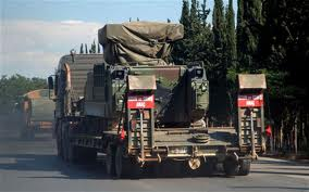 A Turkish military truck transporting a mobile missile launcher into Syria.